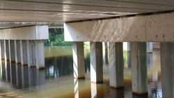 under a dutch bridge with waterreflection