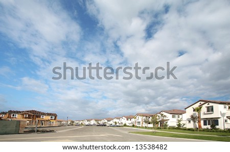 Under Construction And Newer Homes Under Beautiful Scenic Skies