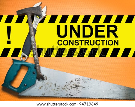 Under construction board with construction right tools