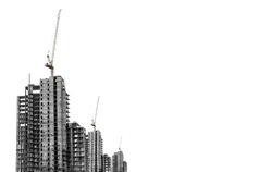 Under construction buildings with tower crane with copy space, isolated on white background