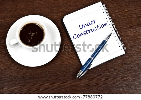 Under construction message and coffee