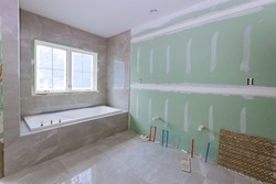 Under construction new bathtub remodeling a home bathroom, plumbing pipe system for new sinks