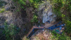 under construction new bridge beside the high mountain for tourist walk from Tharlode Noi cave to Tharlode Yai cave