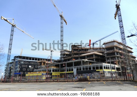Under construction new , McGill University Health Centre (MUHC) is a network of teaching and community hospitals in Montreal, Quebec, Canada affiliated with McGill University. - Shutterstock ID 98088188