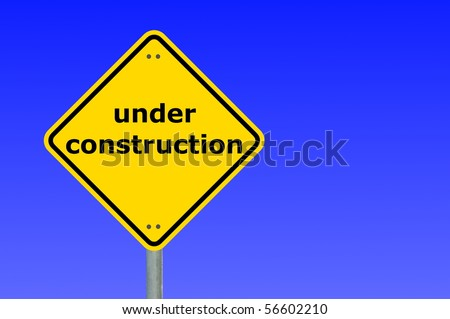 under construction sign and copyspace for a text message