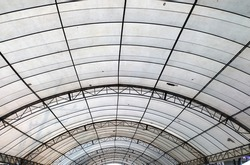 Under large outdoor roof dome construction, canvas and metal for event and parking exhibition.