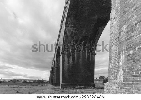 Under one of the 82 arches of Harringworth viaduct,showing the size and scale of this wonderful structure in Black and White, Harringworth, Northamptonshire, England.