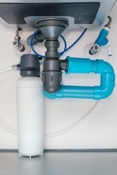 under sink plumbing and drainage system, water purification system install under modern kitchen sink, shallow depth of field