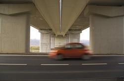 under the bridge with a car