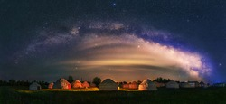 Under the bright Milky Way, Mongolia yurts on the grassland are scattered.