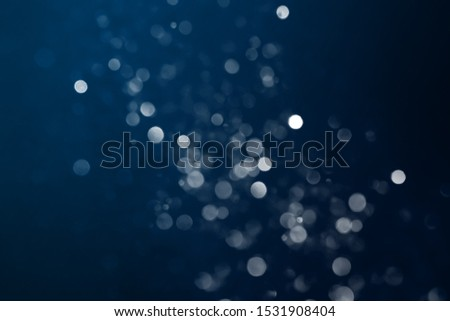 Under the dark backdrop, bokeh creates bright light spots. Use as a background to compose images or different workpieces to make them stand out. Tempting to search in dimension and astonishment