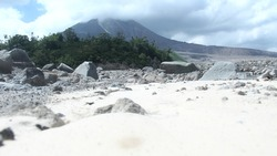 under the foot of Mt. Sinabung and cold lava marks caused by the eruption of Mt. Sinabung