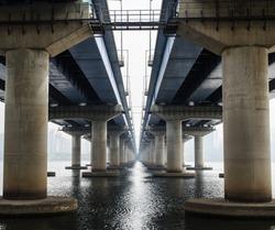 Under the old parallel concrete bridges construction