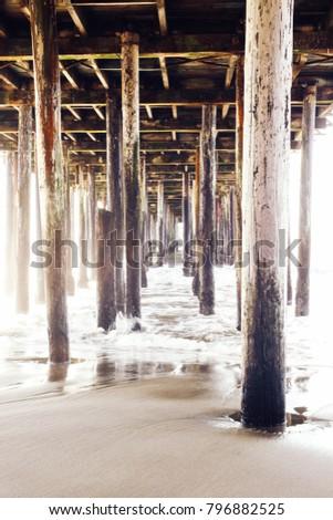 Under the pier in Seacliff State Beach. Aptos, CA.