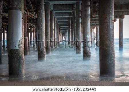 Under the Santa Monica pier long exposure ocean waves #1055232443