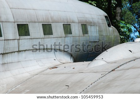 under the wing of a decaying vintage aircraft