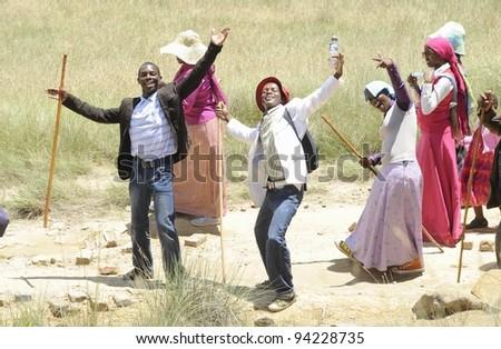 UNDERBERG,SOUTH AFRICA - DECEMBER 25: Unidentified Ikanya mission pilgrims on their way to Nthaba Kudela, their holy mountain in the Drakensberg, on December 25, 2011, Umzimkulwana ,kwazulu Natal, South Africa - stock photo