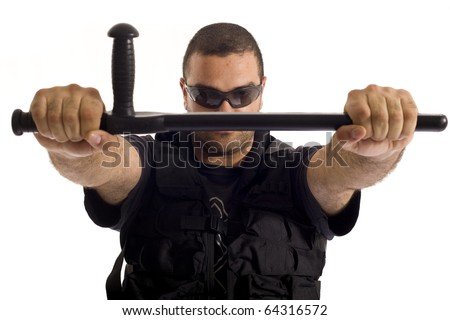 Undercover policeman with a rough look, holding a baton tonfa with both hands