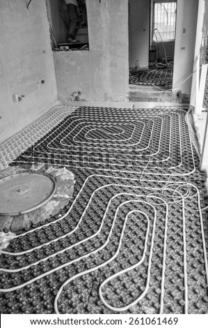 Underfloor heating and cooling indoor climate control for thermal comfort using conduction radiation and convection in black and white