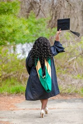 Undergraduate and Post graduate African woman of class 2020 from the University of Pittsburgh showing off poses of jubilation