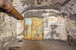 Underground abandoned iron ore mine tunnel with door