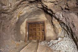Underground abandoned iron ore mine tunnel with doors gates
