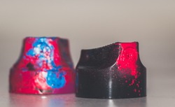 Underground art. Graffiti caps in the paint. Macro shot of spray nozzles with paint.
