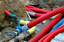 Underground construction of pipes hoses and cables