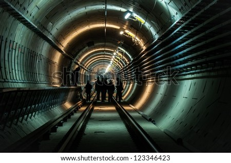 Underground facility with a big tunnel leading deep down stock photo