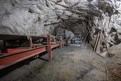 Underground gold mine shaft tunnel with ore transporter