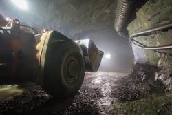 Underground gold ore mine shaft tunnel gallery passage with load, haul, dump machine LHD Toro