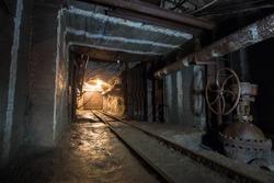 Underground iron ore mine tunnel with waterproof doors and rails