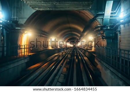 Underground metro tunnel with subway railroad and illumination in dubai, UAE. stock photo