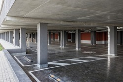 Underground parking is located under the residential building. A place for parking and storage of personal vehicles of residents of a multi-storey building