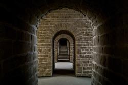 underground passage tunnel through stone walls