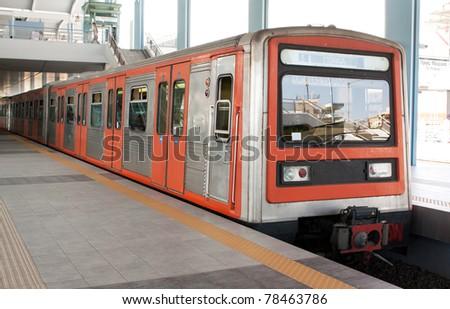 Underground station in Piraeus area, Athens, Greece, and train running from Piraeus to Monastiraki.