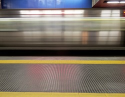 Underground station - metro wagon in motion - blur - yellow stripe orientation for blind people