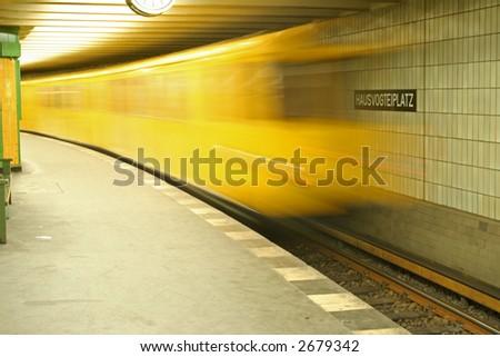 underground train rushing into station