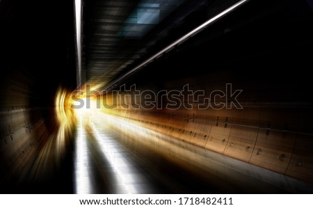 Underground Tunnel in Blurred Motion. Light Tunnel. Subway metro underground tube tunnel. Fast train passing through a railway station at night. Abandoned round subway tunnel under construction.