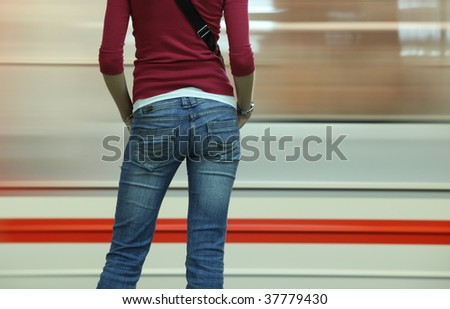 Underground - Young woman waiting for her connection