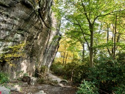 Underlook trail in Coopers Rock State Forest in West Virginia in the fall.  Large rock cliffs and trees in nature.  Great hiking place in the forest.