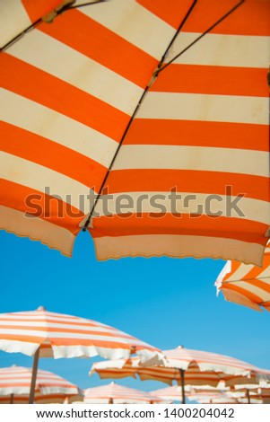 Underneath a Striped Parasol on the Beach in Viarregio #1400204042