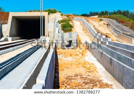 Underpass and tunnel for the construction of a new railway line. Detail of sewage and metal lattice ducts for the electrification of the railway line.