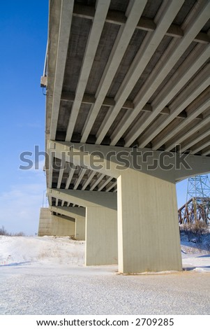 Underside of a concrete ramp leading to the Pierre Laporte Bridge