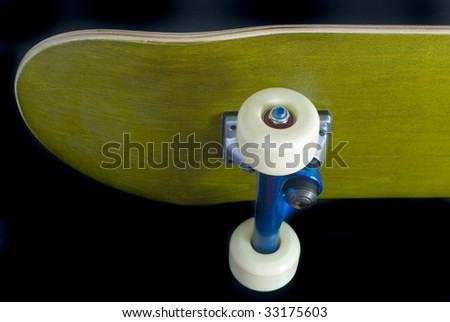 underside of a skateboard deck with blue metallic trucks