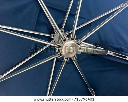 Underside of an umbrella with gear metal