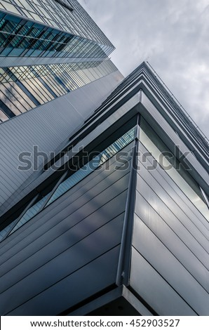 underside panoramic and perspective view to steel blue glass high rise building with reflections, skyscrapers, industrial architecture #452903527