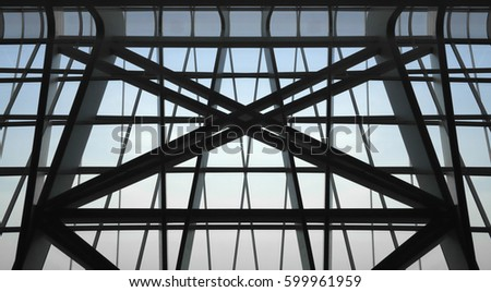 Underside view of structural glass ceiling with crossing metal girders / supporting structures. Reworked photo of modern architecture fragment. #599961959