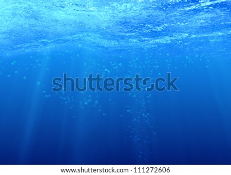 Underwater background with bubbles in sea water