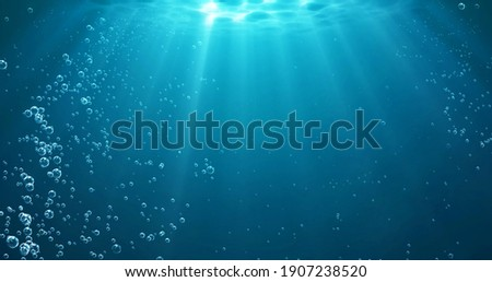 Underwater background with water bubbles and undersea light rays shine